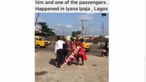 Lady beats up a Danfo driver who abandoned them before getting to their destination in Iyana Ipaja, Lagos
