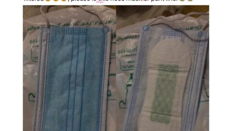 Lady shows the face mask she bought for N400 in Lagos