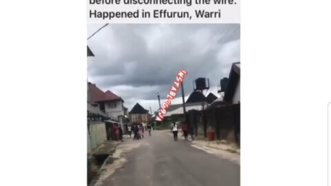 Suspected BEDC staff stranded on an electricity pole as angry residents seize his ladder in Warri, Delta State
