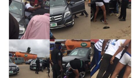Boys labeled yahoo boys for driving Benz, strip naked during a confrontation with the police today in Idiroko, Ogun State.