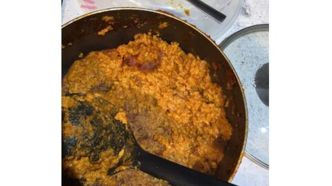 Nigerian man shows off his attempt at cooking Jollof rice