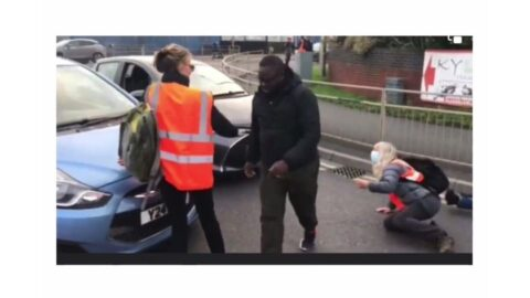 The moment a Nigerian man collaborated with another motorist to sort out some protesters in the UK [Swipe]