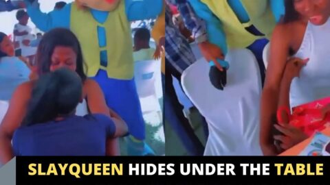 Slayqueen hides under the table after seeing a Mascot at an event