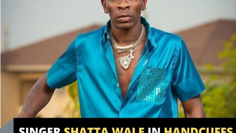 Singer Shatta Wale in handcuffs after being arrested .